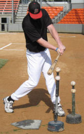 Baseball player hitting with Tee Stackers